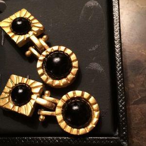 Golden and black earrings